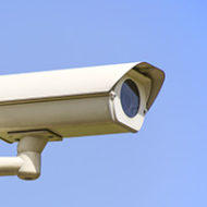 Isolated monitoring cameras on blue sky
